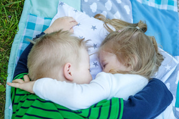 Children preschoolers embrace. Girl and boy. The concept is childhood and family.