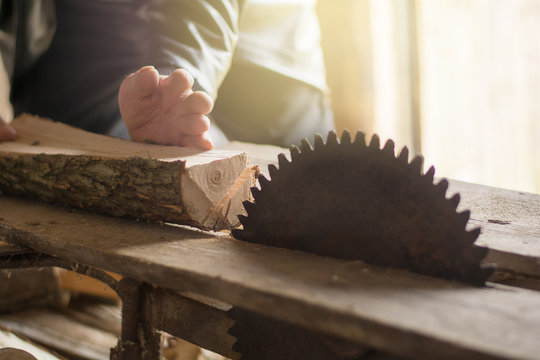 close-up of hand hand with cut-off fingers against the background of a circular saw. Injury and disability in the workplace