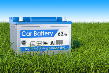 Car Battery on the green grass against blue sky, 3d rendering