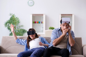 Young couple trying virtual reality glasses goggles