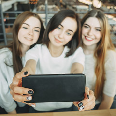 Three friends have fun together and take selfie