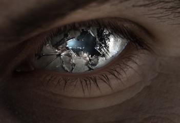Broken eye and glass