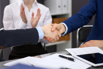 Business people shaking hands, finishing up a meeting. Audit, tax service or agreement concept