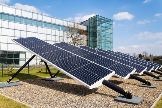 Blue rotating solar panels tilted axis tracker, future innovation energy concept