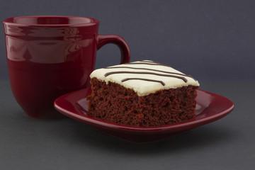 Red velvet cake with crimson mug and plate