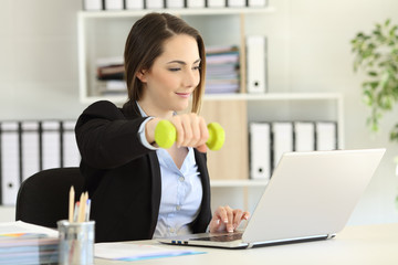 Executive exercising and working at office