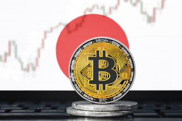 BITCOIN (BTC) cryptocurrency; coin bitcoin on the background of the flag of JAPAN