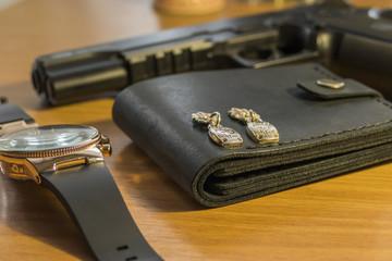 Wallet, watch and gun