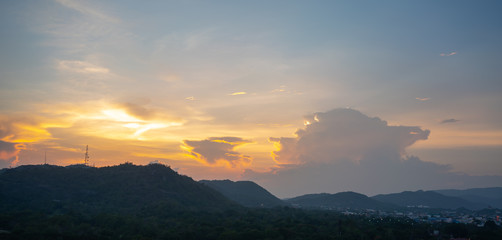 Orange blue sky and clouds above the mountain. Morning  sky with clouds and sun