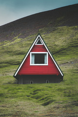 Traditional red A-frame cabin in Iceland