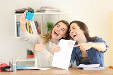 Two students celebrating exam approval