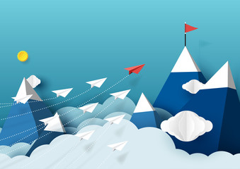 Paper airplanes flying above mountains and blue sky.Paper art style of business teamwork creative concept idea.