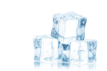 Cubes of clear ice on a white table.