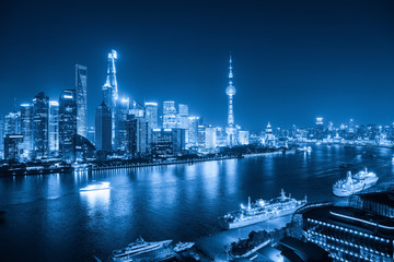 Wall Mural - shanghai skyline at night with blue tone