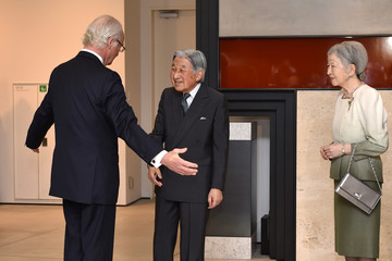 "Sweden's King Carl XVI Gustaf greets Japan's Emperor Akihito and Empress Michiko upon their arrival at the special exhibition ""The Art of Natural Science in Sweden""  at the JP Tower Museum Intermediatheque in Tokyo"