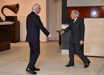 "Sweden's King Carl XVI Gustaf (L) greets Japan's Emperor Akihito at the special exhibition ""The Art of Natural Science in Sweden"" at the JP Tower Museum Intermediatheque in Tokyo"