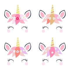 Adorable unicorn heads isolated on white background.