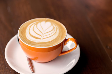latte art coffee on wooden table