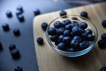 fresh ripe blueberries in glass bowl close up