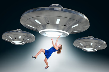 Woman being abducted by UFO - alien abduction concept