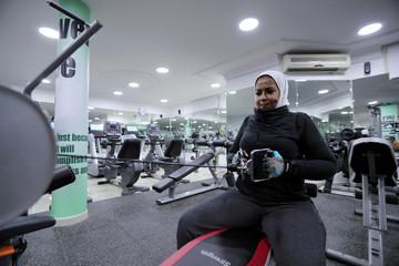 Saudi Reham Al Shaban works out at a local gym in Qatif, Saudi Arabia