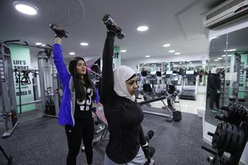 Saudi Wadiha Al Dar (R) and Rana Al Shammaai (L) work out in a local gym in Qatif, Saudi Arabia