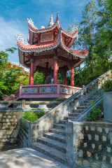 gazebo with a bell in a Buddhist style, on the territory of the active pagoda Long Shon, Nha Trang, Vietnam