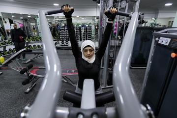 Saudi Wadiha Al Dar works out in a local gym in Qatif, Saudi Arabia