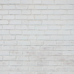The texture of the brick wall, painted in white