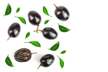Dark grapes decorated with green leaves isolated on white background with copy space for your text, top view. Flat lay