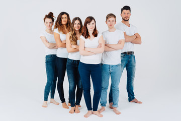 Group of young barefoot students in jeans
