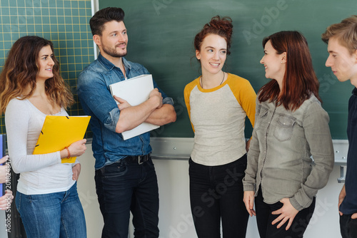 teacher talking with students in class fotolia com の ストック写真と