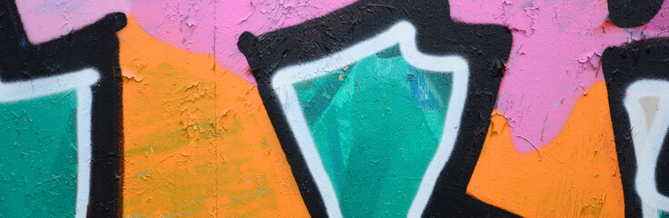 Fragment of a beautiful graffiti pattern in pink and green with a black outline. Street art background image