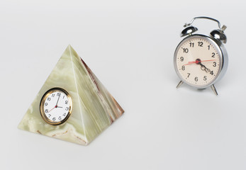clock from onyx and alarm clock, on white background
