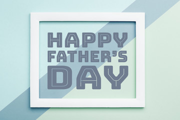 Happy Father's day Pastel Candy Colours Background. Flat lay minimalism Father day greeting card with picture frame.