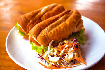 French baguette with salad on plate. Rich breakfast in european style. Tasty yummy baguette.