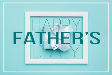Happy Father's day Pastel Candy Colours Background. Flat lay minimalism greeting card with picture frame and beautiful present.