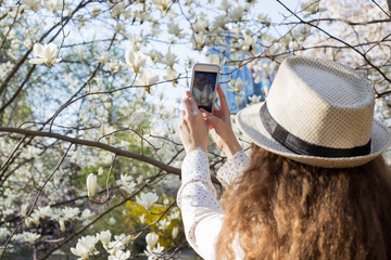 Girl takes pictures of flowers