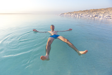 Tourist swims in Dead Sea. Jordan