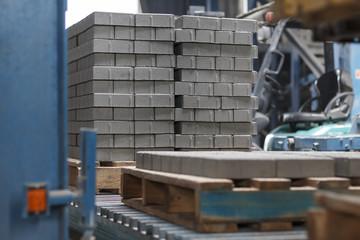 Production of concrete paving stones