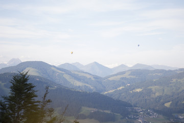 Mountain view panoramic in the alps with two ballons flying