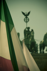 Hungarian or iranian flag in front of the quadriga at the brandenburg gate in berlin