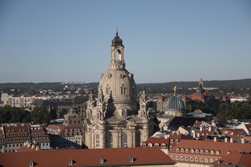 The famous church of our lady the dresdner frauenkirche in evening light aerial shot from another tower with blue sky on a sunny day