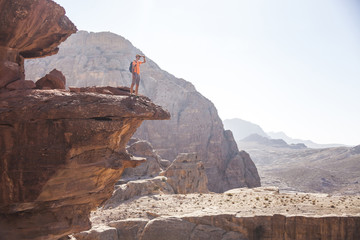 Tourist on rock in Petra. Jordan landscape