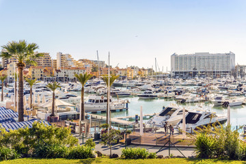 Marina full of luxurious yachts in touristic Vilamoura, Algarve, Portugal