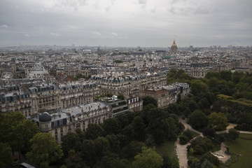 View from the eiffel tower over paris with buildings streets, churches