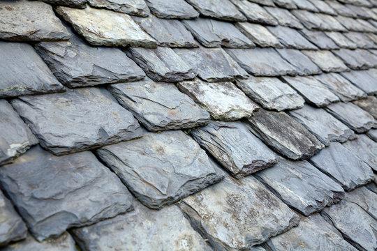 Aged slate tile roof background
