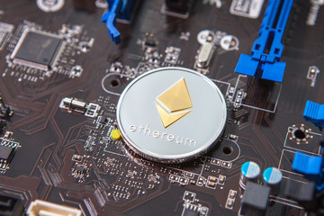 Coin ethereum on the background of a microcircuit. Crypto currency etherium close-up. Mining. Crypto.
