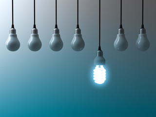 One hanging eco energy saving light bulb glowing and standing out from unlit light bulbs on dark green blue background , leadership and different creative idea concept. 3D rendering.