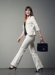Businesswoman on a gray background